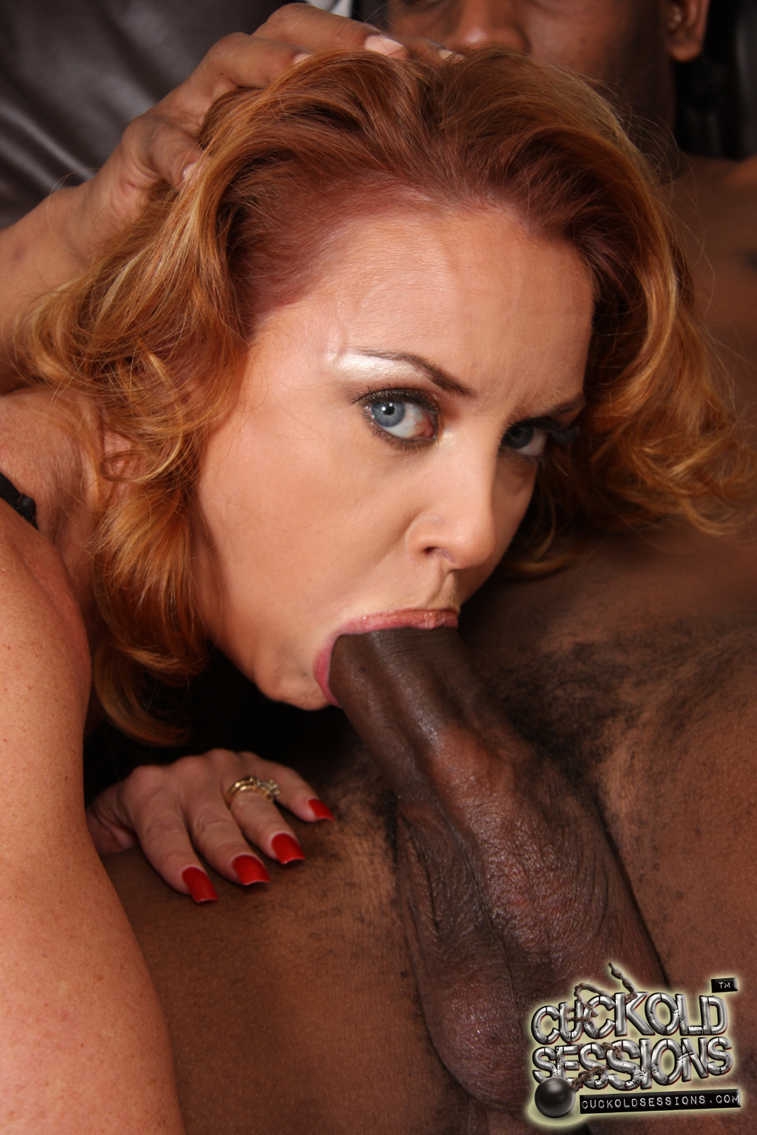 a busty redhead doing two black guys on this one from bob